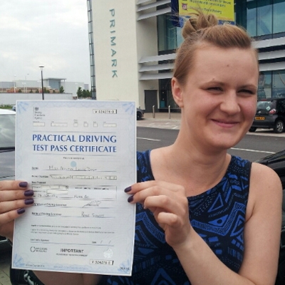 Image of Ashleigh Dixon with pass certificate - Revolution Driving School