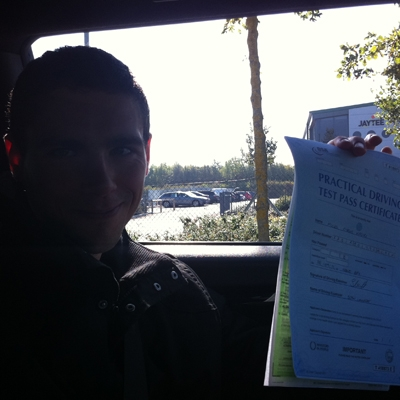 Image of Miles Kasari with pass certificate - Revolution Driving School